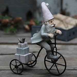 Vintage Tomtenisse på cykel